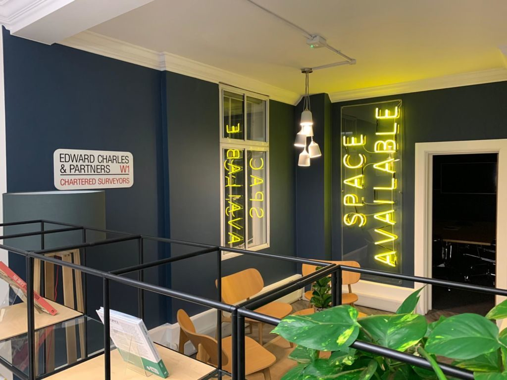 """Space Available"" neon signage at Edward Charles and Partners office"