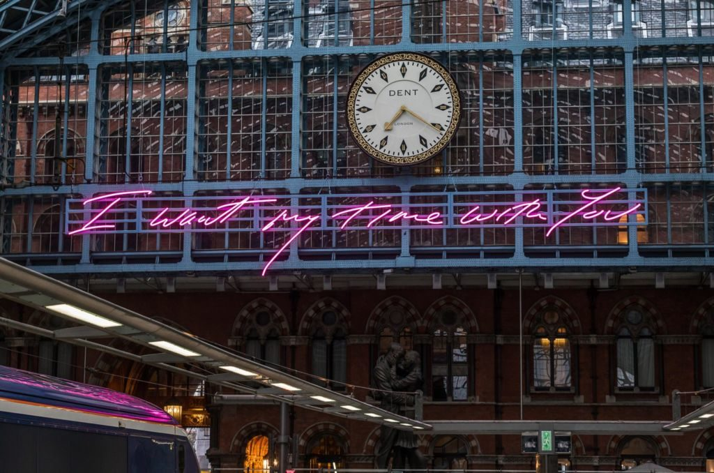 "Neon sign in St Pancras Station by Tracey Emin says: ""I want my time with you""."
